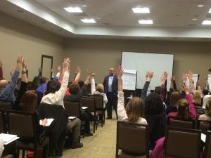 15_Corporate_Leadership_Hands Raised